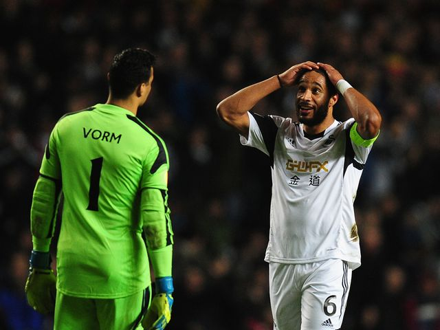 Ashley Williams and Michel Vorm react during the 0-0