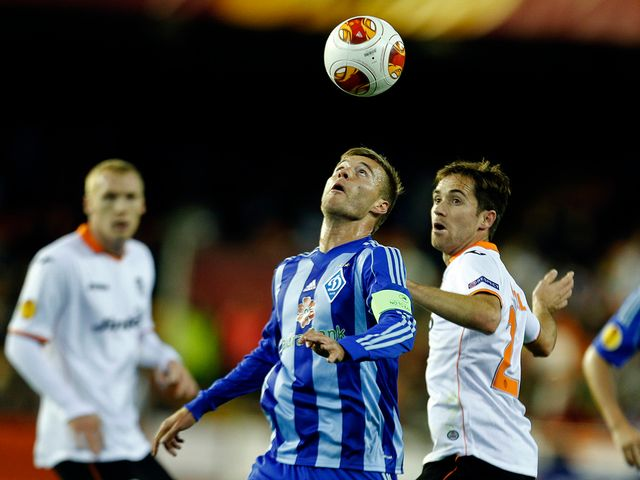 Andriy Yarmolenko and Michel have eyes only for the ball