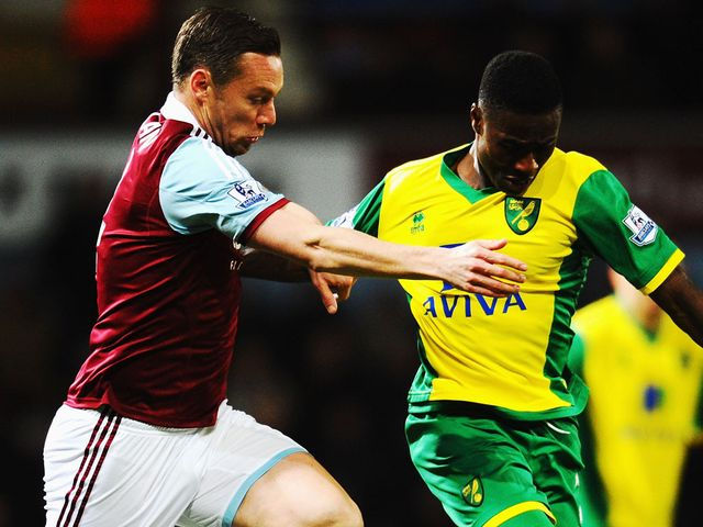 Kevin Nolan and Alexander Tettey battle for possession