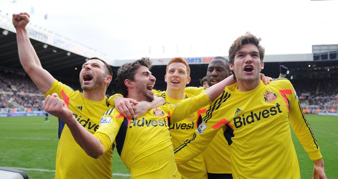 Fabio Borini: Sunderland celebrate after scoring the opener at Newcastle