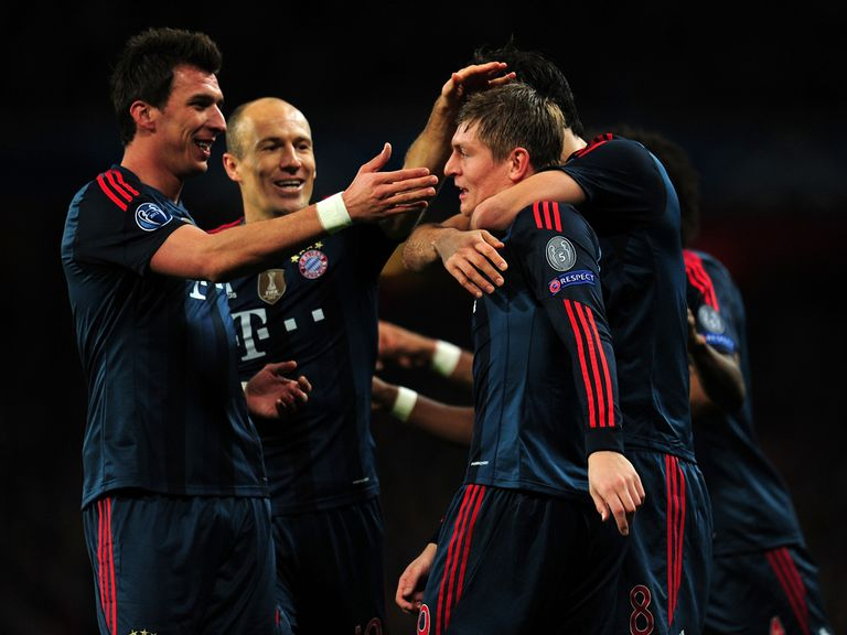 Toni Kroos is mobbed after scoring in the first leg