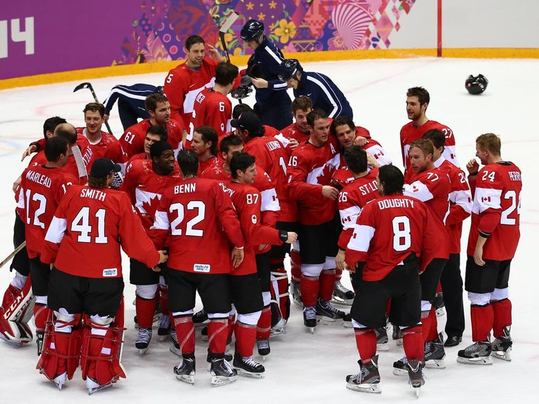 Canada celebrate their victory over Sweden