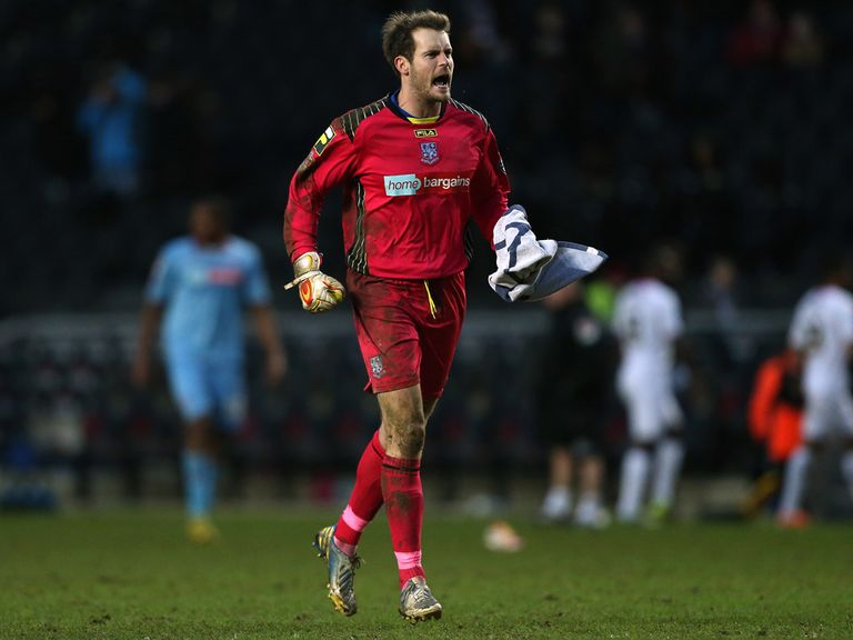 Tranmere goalkeeper Owain Williams celebrates victory