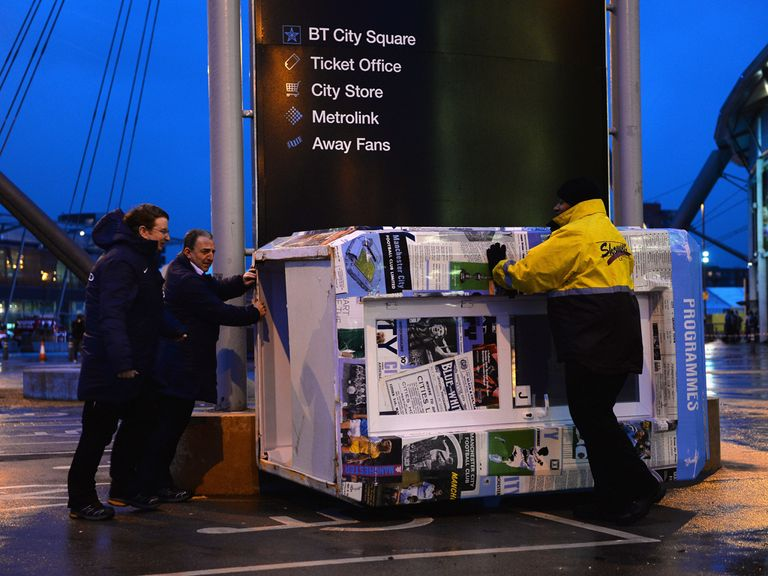 A programme booth blows over outside the Etihad Stadium