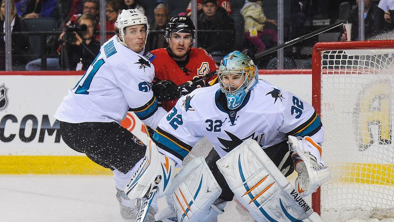 San Jose Sharks duo Justin Braun (l) and Alex Stalock (r) attempt to deny Calgary's Curtis Glencross