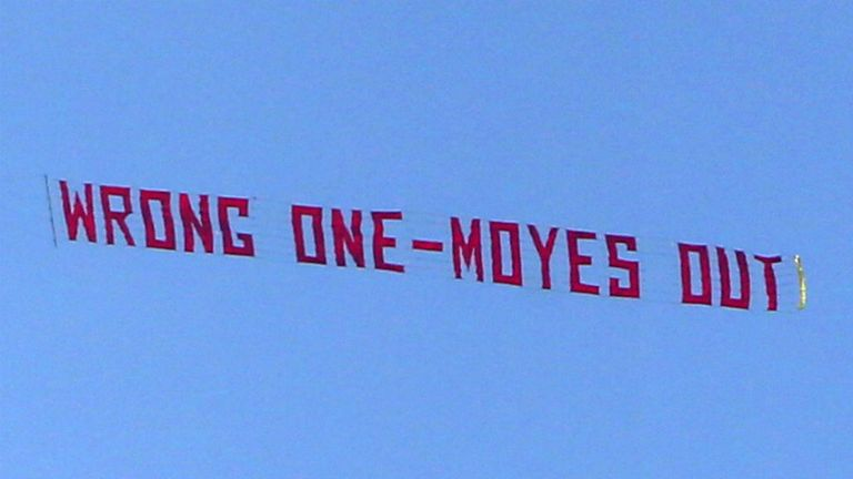 Banner protest: An airborne message passes over Old Trafford during the game against Aston Villa