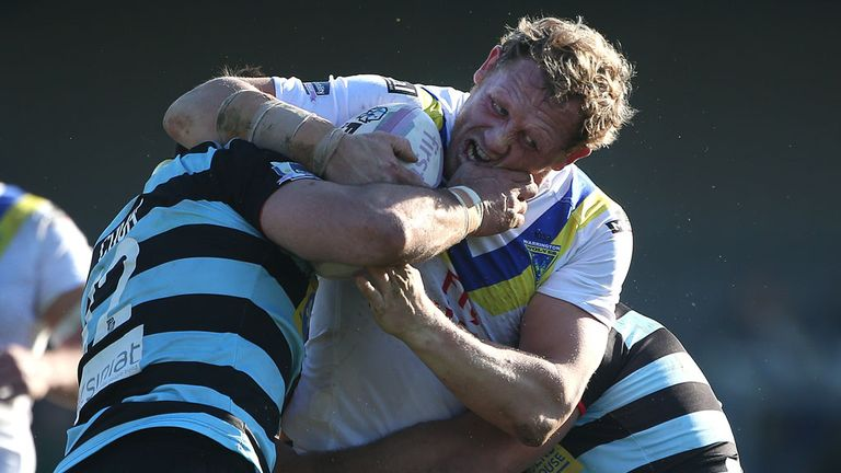 Warrington's Ben Westwood tries to break a tackle against London Broncos