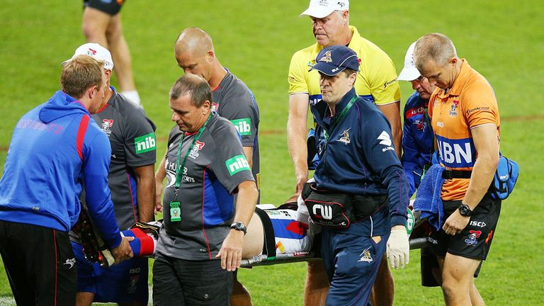 Alex McKinnon: Newcastle forward is carried off the pitch after breaking his neck