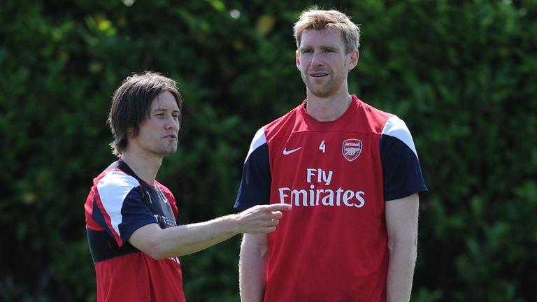 Tomas Rosicky (l) and Per Mertesacker: Duo have signed new contracts with Arsenal