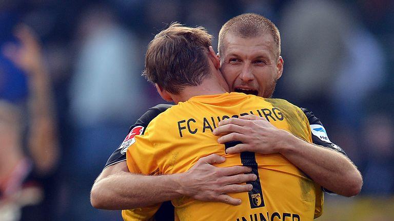 Ragnar Klavan and Alex Manninger celebrate Augburg's success