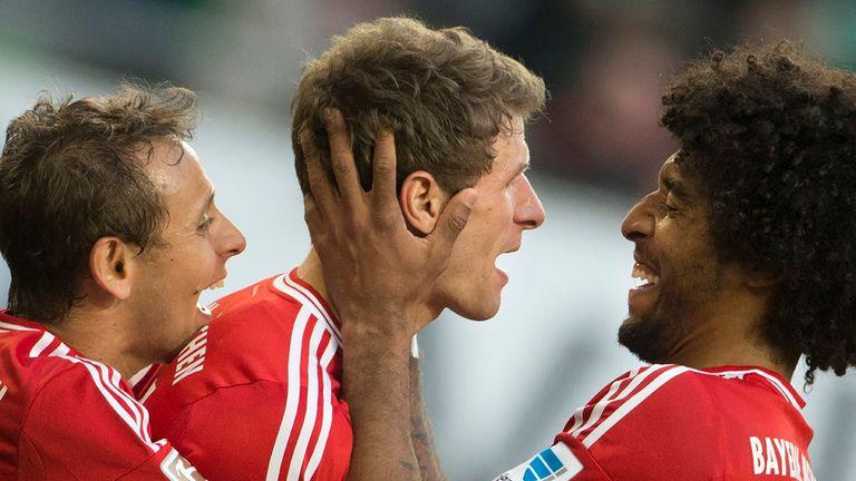 Thomas Mueller celebrates one of his three goals