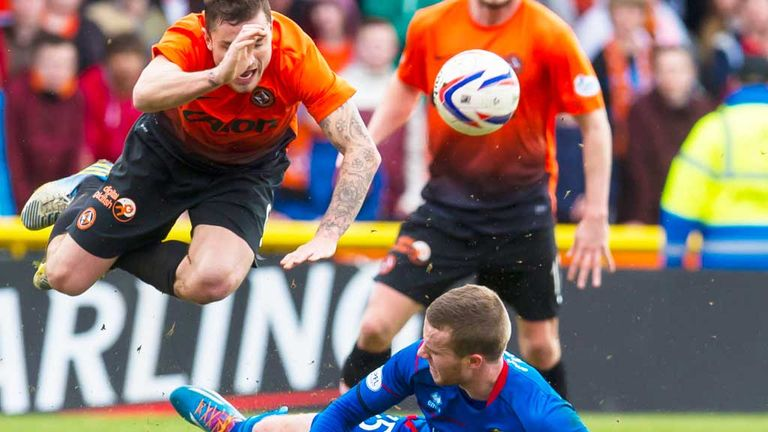 Inverness Caley's Marley Watkins (grounded) fouls Dundee United's Paul Paton