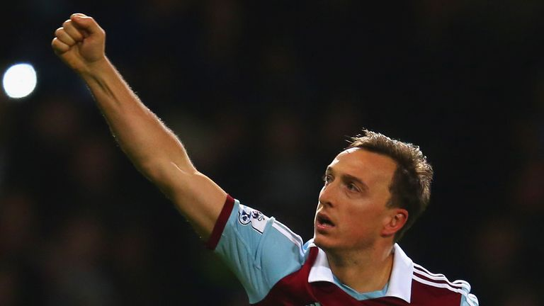 Mark Noble of West Ham celebrates scoring the opening goal from the penalty spot against Hull