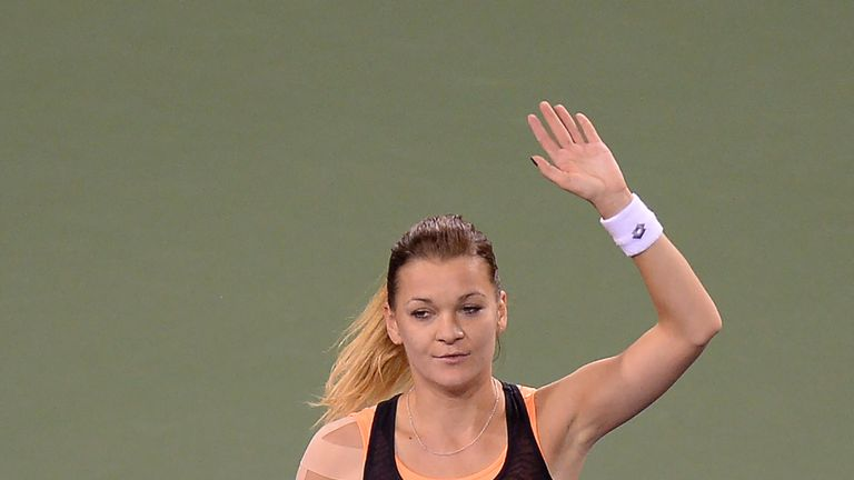 Agnieszka Radwanska celebrates her victory over Jelena Jankovic