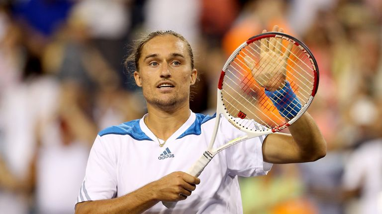 Alexandr Dolgopolov celebrates his win over Rafael Nadal