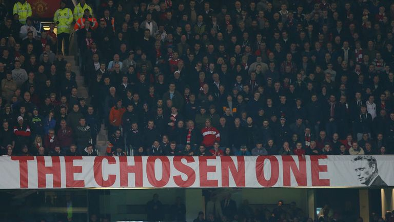 'The Chosen One' banner: Guarded by stewards during Manchester derby