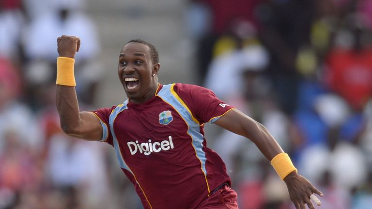 Dwayne Bravo of the West Indies celebrates catching and bowling Joe Root of England during the 2nd One Day International