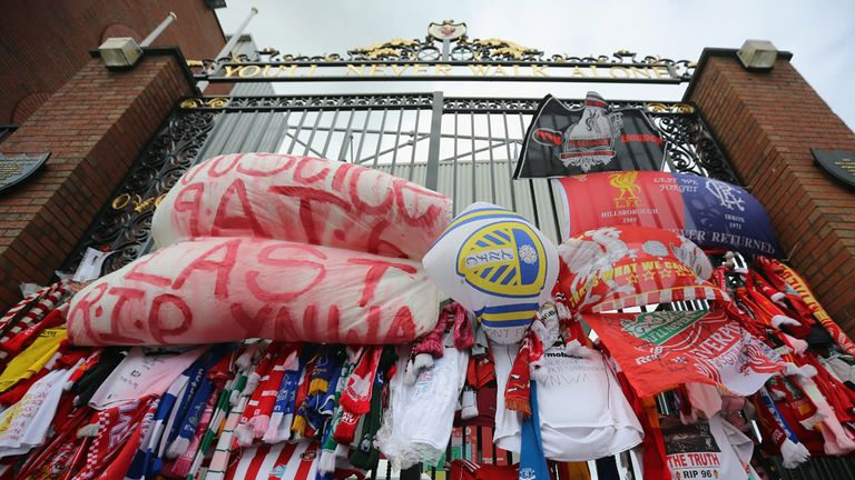 Tributes to the victims of the Hillsborough Disaster adorn the Hillsborough memorial and the Bill Shankly gates at Anfield stadium
