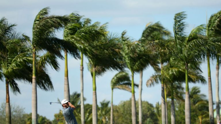 Dustin Johnson: American has a share of the lead after strong winds hit Doral on day two