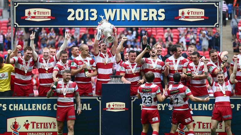 Wigan captain Sean O'Loughlin lifts the trophy after last year's success over Hull FC