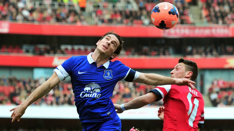 Leighton Baines: Everton defender challenge Mesut Ozil at the Emirates