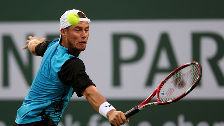 Lleyton Hewitt hits a return to Matthew Ebden during the BNP Paribas Open at Indian Wells