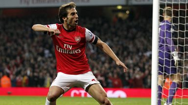 Mathieu Flamini celebrates his leveller against Manchester City
