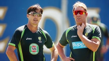 Brad Hogg (left): Chats to Shane Warne during a practice session