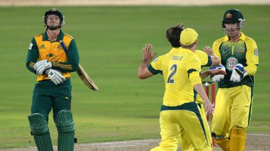 Australia celebrate the wicket of Quinton de Kock