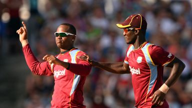 Marlon Samuels (left): West Indies all-rounder hit 69 not out and claimed 2-21