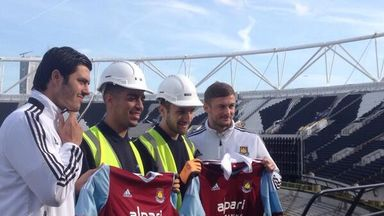 James Tomkins and George McCartney at the Olympic Stadium with local apprentices