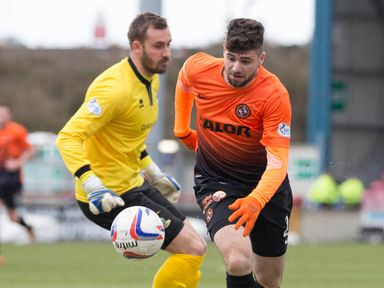 Nadir Ciftci rounds Dean Brill to score the opening goal