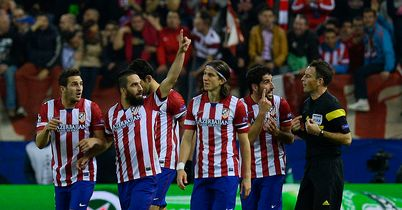 Atletico progress with ease