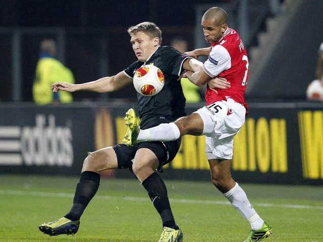 Simon Poulsen (R) fights for the ball with Aleksandr Bukharov