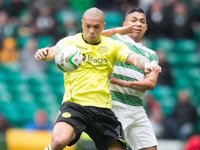 Josh Magennis stays ahead of Emillo Izaguirre