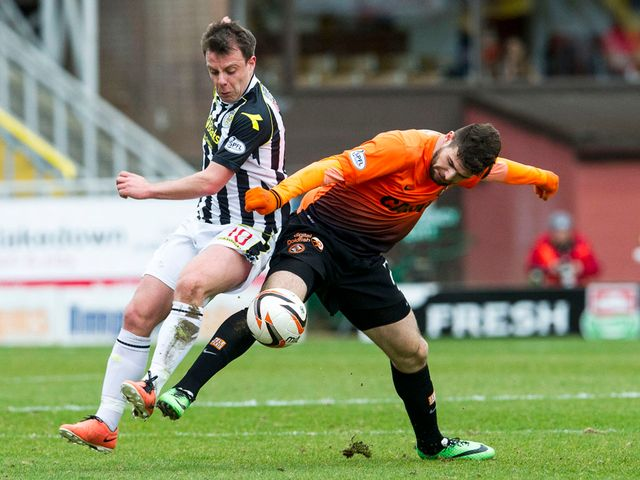 Paul McGowan and Nadir Ciftci battle for the ball