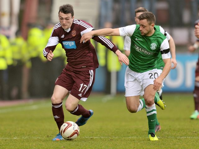 Hearts' David Smith (left) battles with Tom Taiwo