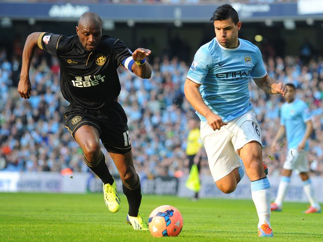 Sergio Aguero gets away from Emmerson Boyce