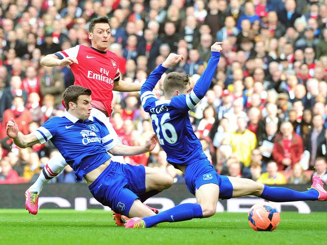 Mesut Ozil drills Arsenal into an early lead