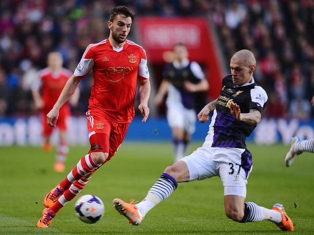 Jay Rodriguez is tackled by Martin Skrtel