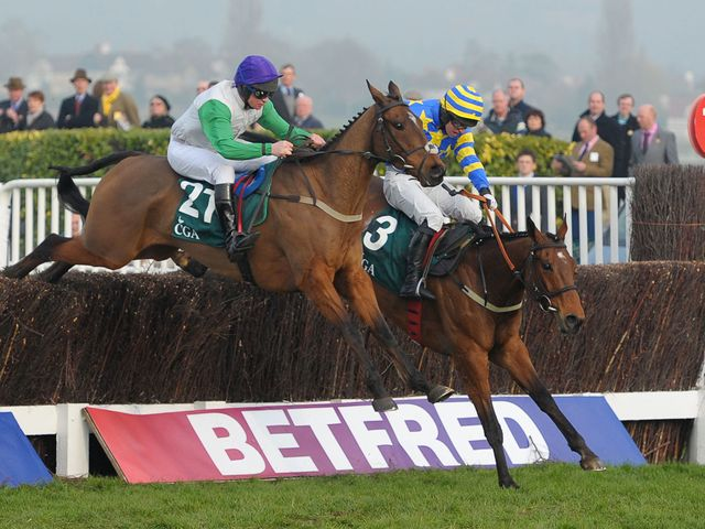 Tammys Hill (left) jumps to victory in the Foxhunters