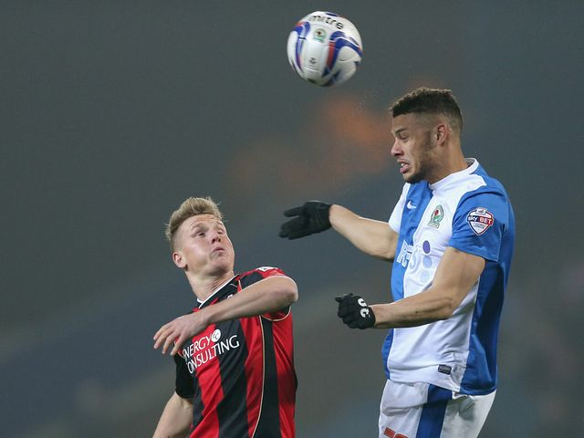 BLACKBURN, ENGLAND - MARCH 12:  Rudy Gestede of Blackburn Rovers in action with Matt Richie of Bournemouth