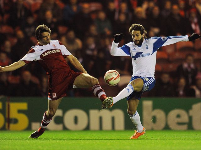 George Friend and Djamel Abdoun battle for the ball