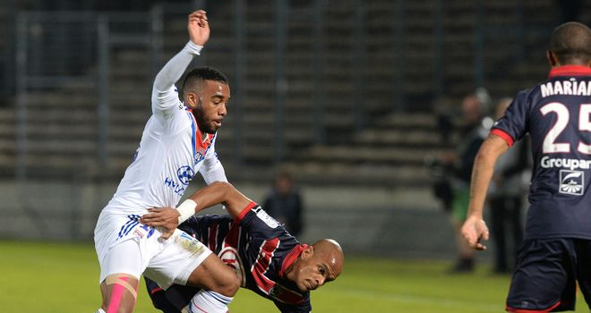 Alexandre Lacazette tussles for the ball