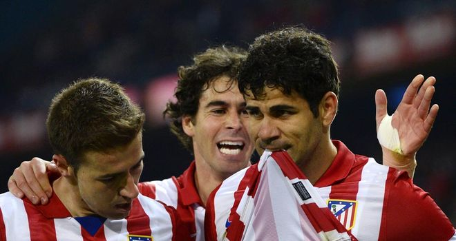 Diego Costa (r) celebrates his goal