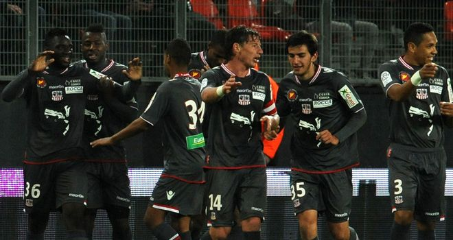 Issa Baradji (l) celebrates with his Ajaccio team-mates