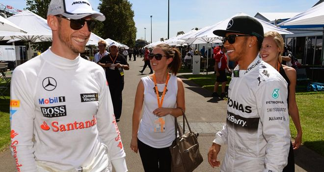 Button greets former team-mate Lewis Hamilton in the Melbourne paddock