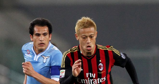 Cristian Ledesma and Keisuke Honda battle for the ball