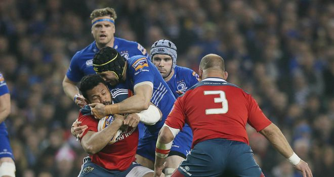 Munster's Casey Laulala tangles with Leinster's Kevin McLaughlin