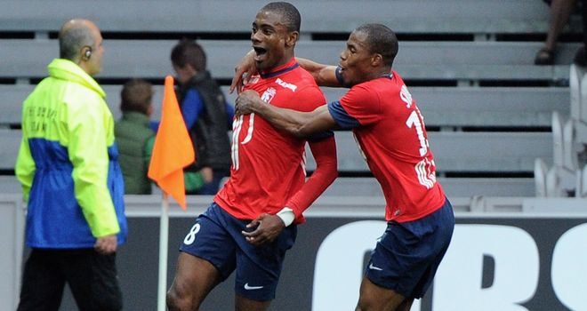 Salomon Kalou (left) celebrates are scoring at the death